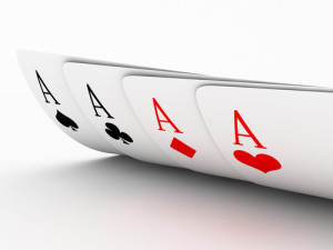 Hand of cards with four aces